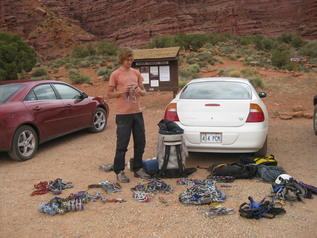 Aaron sorting gear in the parking lot.