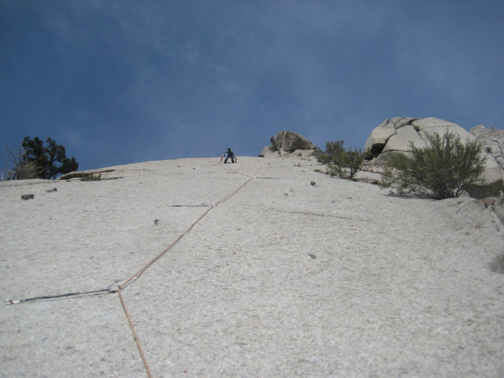 Some dude on the second pitch chimney/OW on Crescent Crack.