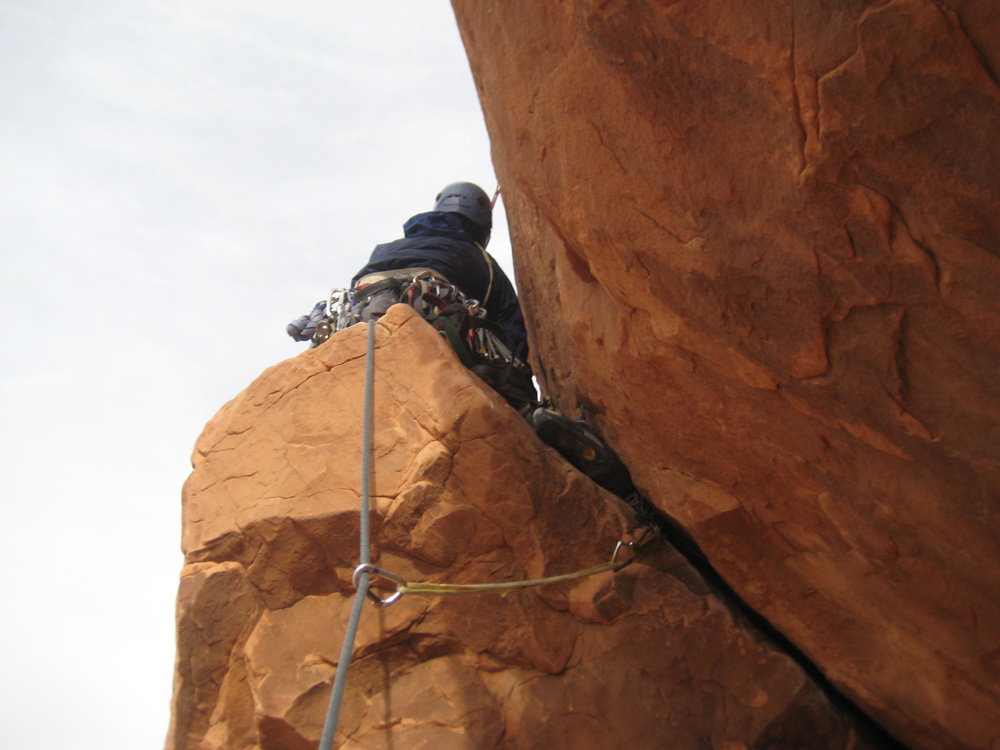 Me snaking my way past the start of pitch 2.