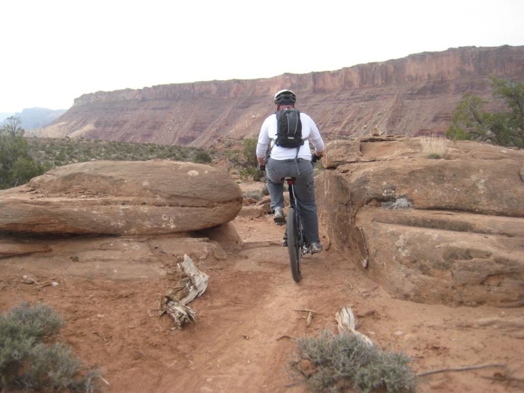Christian riding through a gap.