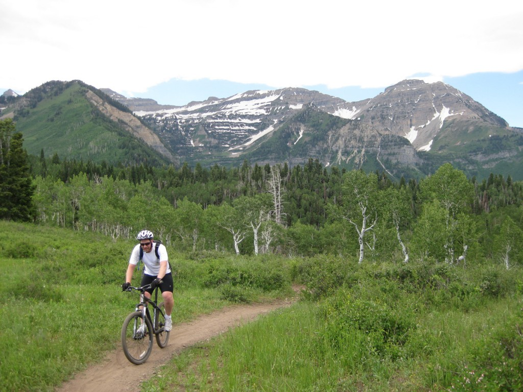 Crisco biking in front of Mt. Timpanogos.