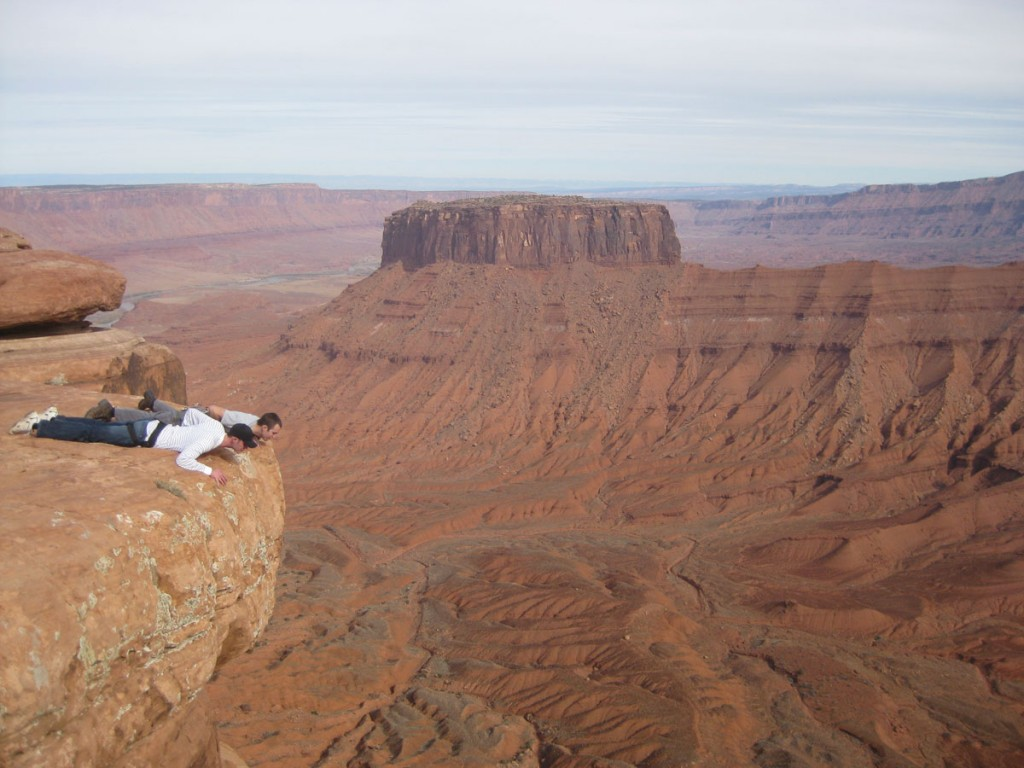 Spencer and Russ looking over the edge, with hundreds of feet of nothingness below them.