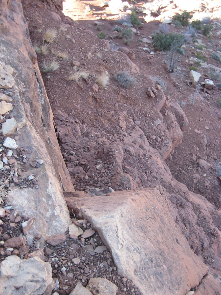 The downclimb of the crux.