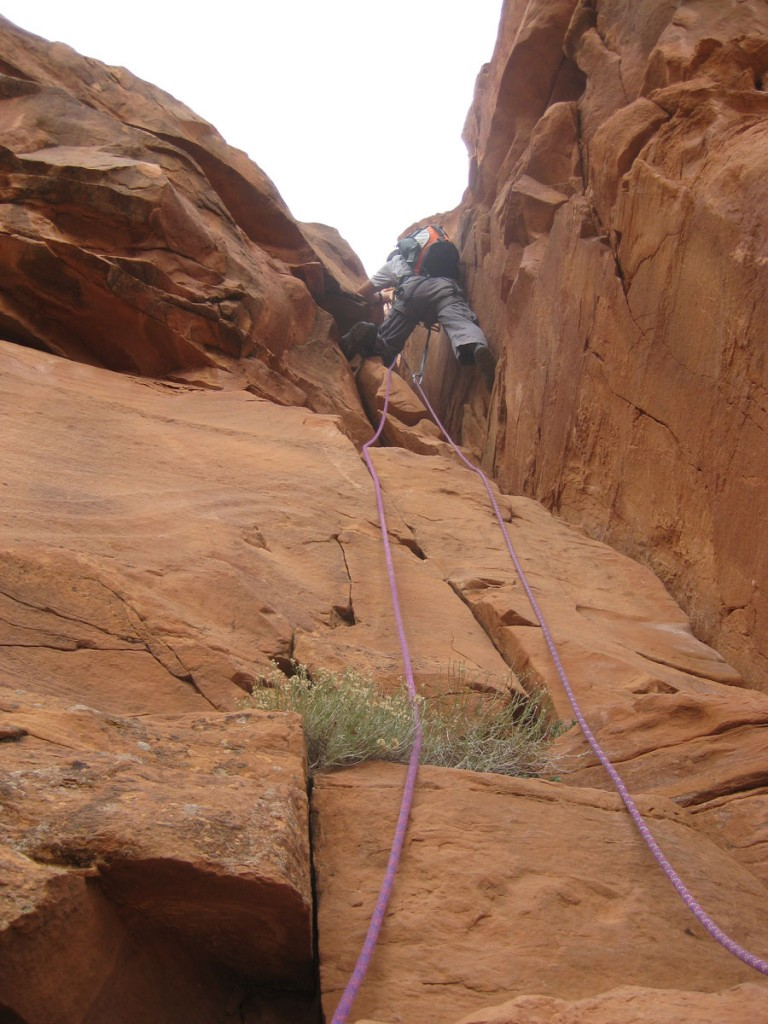 Spencer going up the 5th class section with fixed ropes.