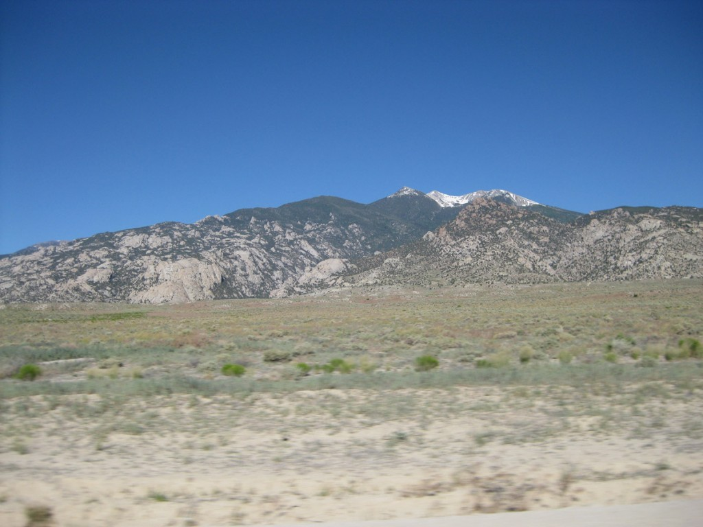 A closer look at the mountain and the granite cliffs at its base.
