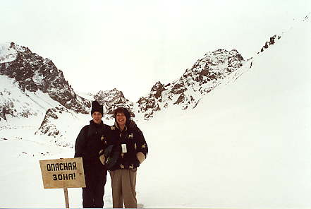 """Me and mom. The sign says """"Dangerous Zone""""."""