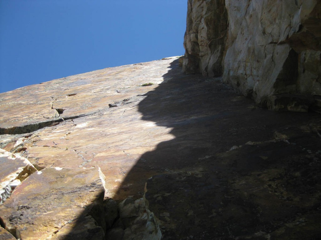 Looking up the thin corner crux of pitch 2.